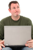 Man with Laptop Thinking Stock Images