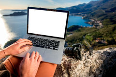 Man with laptop on the top of mountain Stock Photo