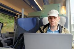 Man with laptop in a train royalty free stock images