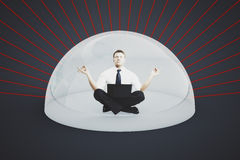 Man with laptop under shield Royalty Free Stock Image