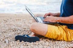 Man with laptop working outdoor Stock Photos