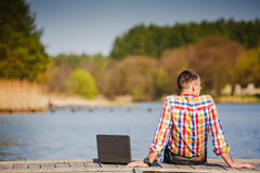 Man with laptop working outdoor Stock Photo