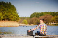 Man with laptop working outdoor Royalty Free Stock Images