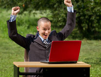 Man with laptop working outdoors Royalty Free Stock Photography