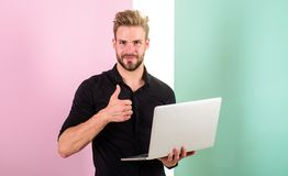 Man with laptop works as smm expert. Guy stylish modern appearance manager producing content for social networks. Social. Media marketing expert. Smm manager royalty free stock photography