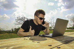 A man with laptop - Sitting in the garden Royalty Free Stock Image