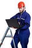 Man with laptop in workwear Stock Photography
