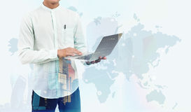 Man with laptop and world map Stock Photos