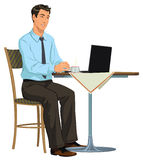 Man with a laptop. Young businessman sitting in an Internet cafe Royalty Free Stock Photos