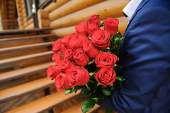 Man with a large bouquet of roses stock image