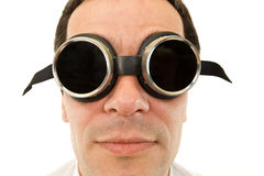 Man with large dark protective goggles Stock Photo