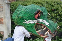 Man with large Dragon head and George and the Dragon re-enactment. KENTWELL HALL SUFFOLK UK : May 05, 2014: Man with large Dragon head and George and the Dragon Stock Photos