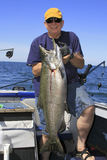 Man with Large Fish - Lake Ontario King Salmon Royalty Free Stock Photo