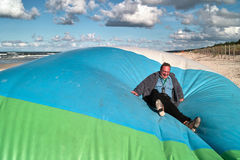 Man on large inflatable Stock Image