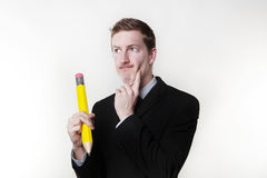 Man with large pencil Stock Images