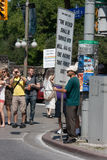Man with Large Protest Sign at Pride Parade. OTTAWA, CANADA - AUGUST 26:  A man with a large sign protesting at the Capital Pride Parade on August 26, 2012 in Stock Photo