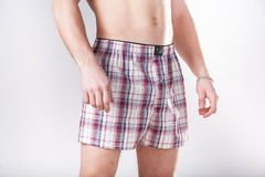 The man in large red shorts Royalty Free Stock Image