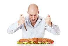 Man with large sandwich. Royalty Free Stock Image