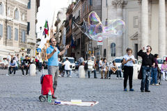 Man with large soap bubbles Royalty Free Stock Photos