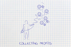 Man with lasso collecting profits. Collecting profits: man with lasso grabbing coins Royalty Free Stock Photo