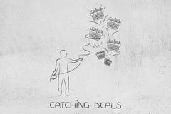 Man with lasso grabbing shopping baskets. Catching deals: man with lasso grabbing shopping baskets Royalty Free Stock Photos