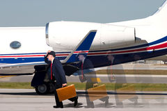 Man late for his flight. Carrying a briefcase Stock Photography