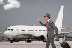 Man late for his flight. Running after a jet Royalty Free Stock Images