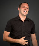 Man in a laugher fix Stock Image