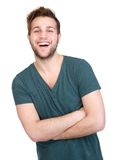 Man laughing with arms crossed on Royalty Free Stock Photography