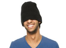 Man laughing with black hat covering eyes Stock Photography