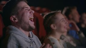 Man laughing at comedy film. Male emotion at movie entertainment