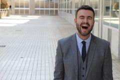 Man laughing with eyes closed.  royalty free stock photos