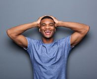 Man laughing with hands on head Royalty Free Stock Photography