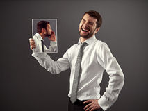 Man laughing at a joke Stock Photography