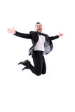 Man Laughing and Jumping Up, Enjoying His Success Royalty Free Stock Photos