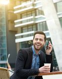 Man laughing with mobile phone Stock Images