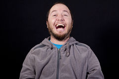 Man laughing out loud. Isolated on black background Royalty Free Stock Images