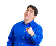 Man laughing at someone Stock Image