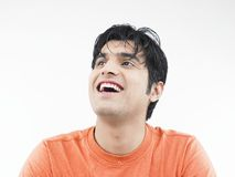 Man laughing to a joke Stock Photos