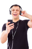 Man laughing watching and listening radio show on mobile phone Royalty Free Stock Image