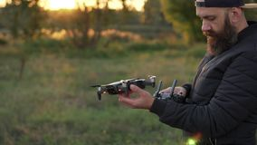 Man launches drone from his hand stock video