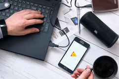 Man launches Google Play application Royalty Free Stock Image