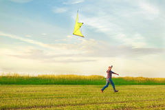 A man launches a kite royalty free stock image