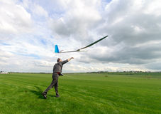 Man launches into the sky RC glider Royalty Free Stock Image