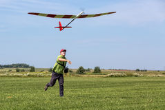 Man launches into the sky RC glider Royalty Free Stock Photo