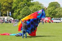 Man launching a large kite. Stock Photo