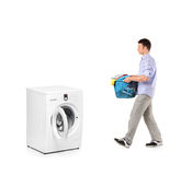 Man with a laundry basket Stock Photos
