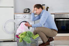Man With Laundry Basket Holding Stained Cloth Stock Photos
