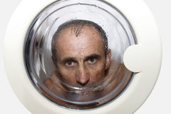 Man  in laundry washer Stock Photography