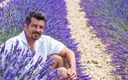 Man in the lavander fields. Young man admiring the lavander fields in Valensole. Provence, France Royalty Free Stock Image